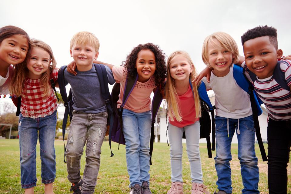 Portrait Of Happy Elementary Kids Playing on a Break