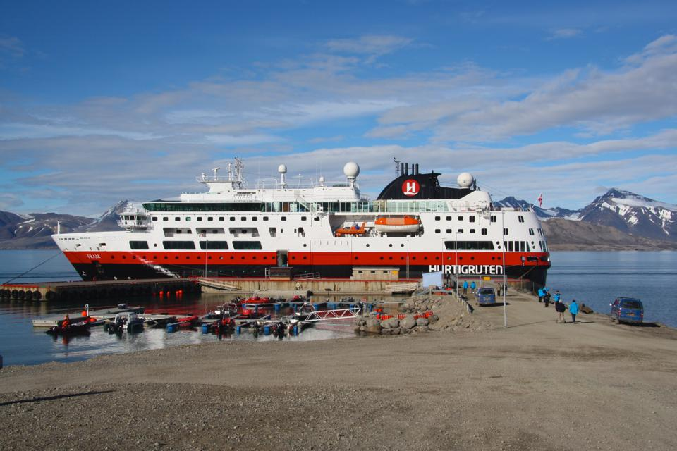 A Hurtigruten expedition vessel docked in Ny-Ålesund, Svalbard.
