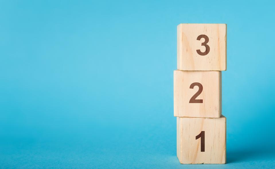 Wooden alphabet number blocks 123 on blue background