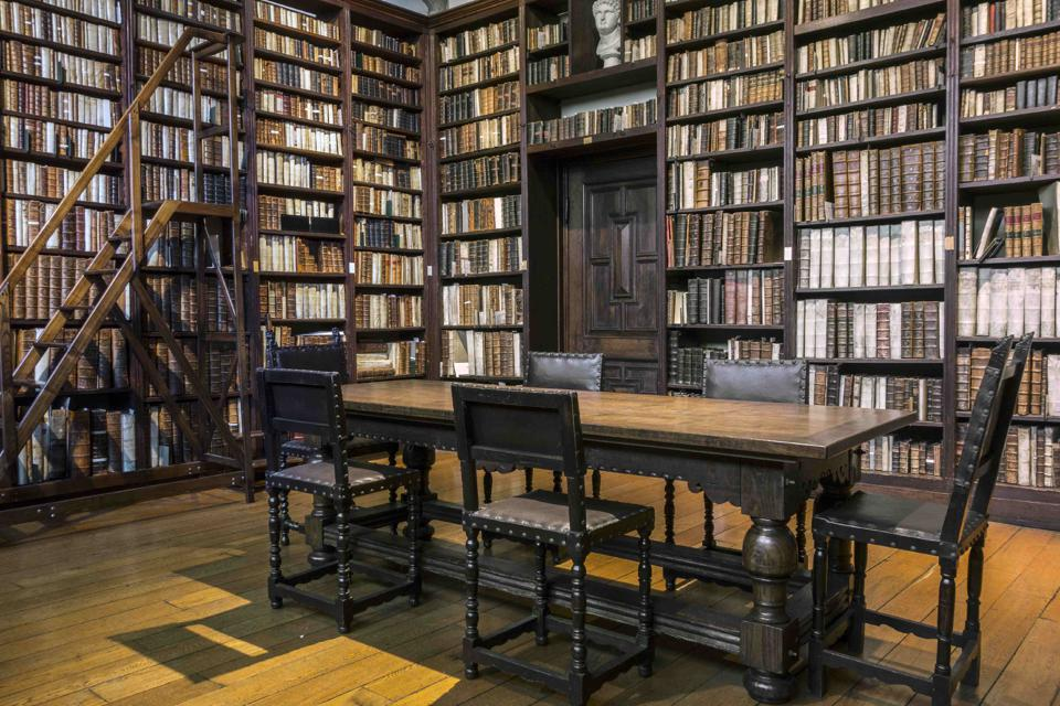 Bookshelves with old books in the Small Library at the Plantin-Moretus Museum.