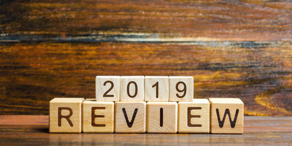 Wooden blocks with the word Review 2019. Business concept. Feedback, Progress. New trends and prospects. Financial performance indicator. Results of the year. Financial and economic activities. Audit.