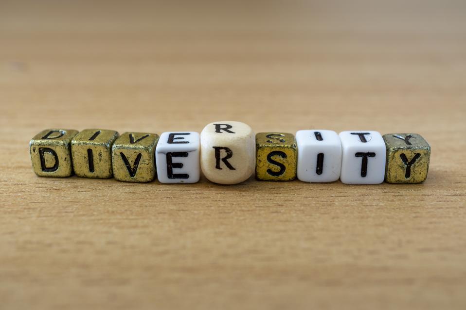 Diversity word sign on a wooden desk