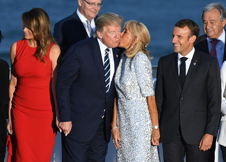 French President's wife Brigitte Macron kisses US President Donald Trump on August 25, 2019 in Biarritz, France.