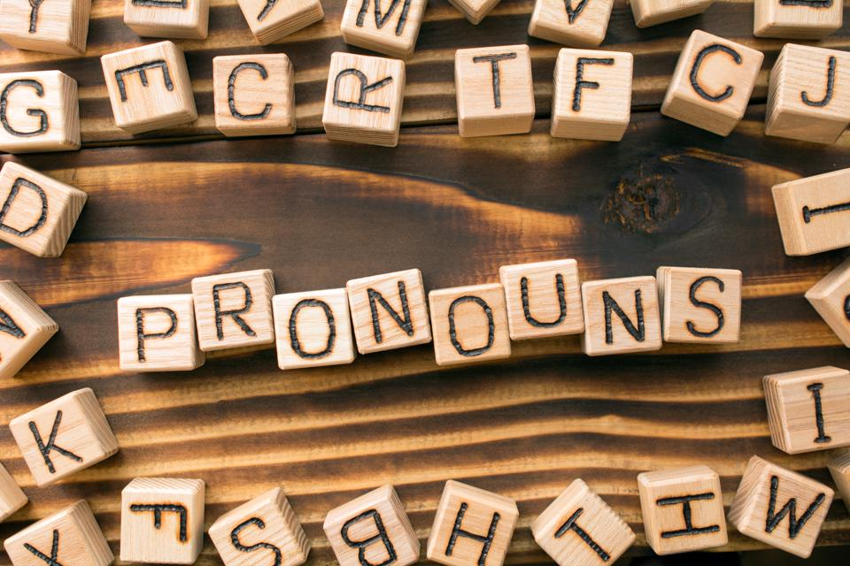 word pronouns composed of wooden cubes with letters