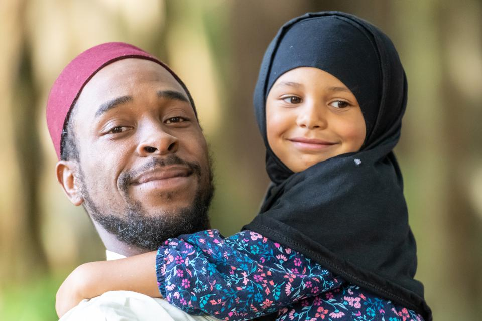 Muslim father and daughter at her first day of school