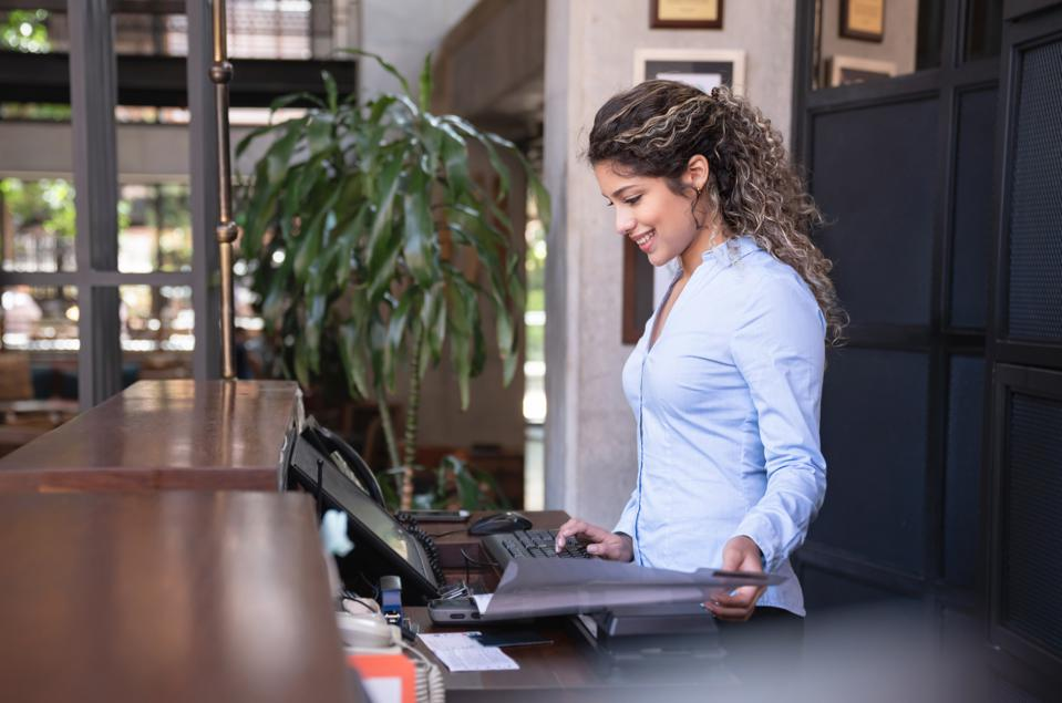 Receptionist at front desk
