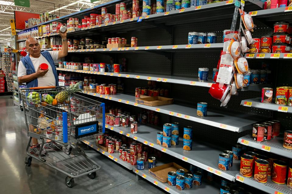 us-weather-hurricane-preparations  Supplies at a Walmart in West Miami run low on August 30, 2019, as residents prepare for Hurricane Dorian. - Dorian was on a collision course with Florida on Friday as residents stocked up on food and water and battened down their homes to ride out the storm and others prepared to evacuate. Weather forecasters said Dorian, currently a Category 2 hurricane, could strengthen into a powerful Category 4 storm before it makes landfall but there was a great amount of uncertainty about where it would hit. Dorian is forecast to make landfall September 2. (Photo by Eva Marie UZCATEGUI / AFP)        (Photo credit should read EVA MARIE UZCATEGUI/AFP/Getty Images)