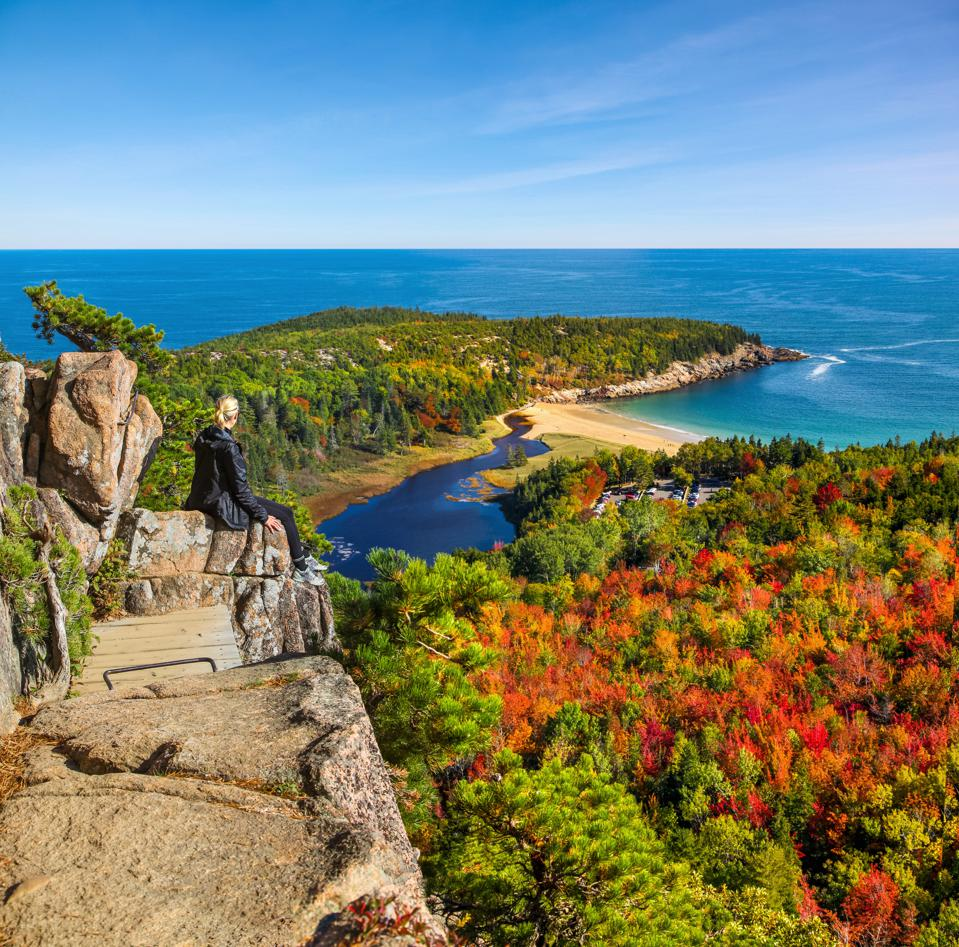 Female hiker enjoying the view from Beehive Trail in Acadia