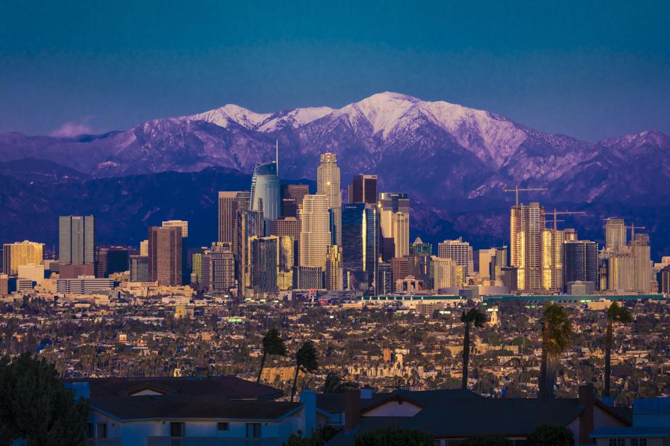 Los Angeles Skyline framed by San Bernadino Mountains and Mount Baldy with fresh snow from Kenneth Hahn State Park
