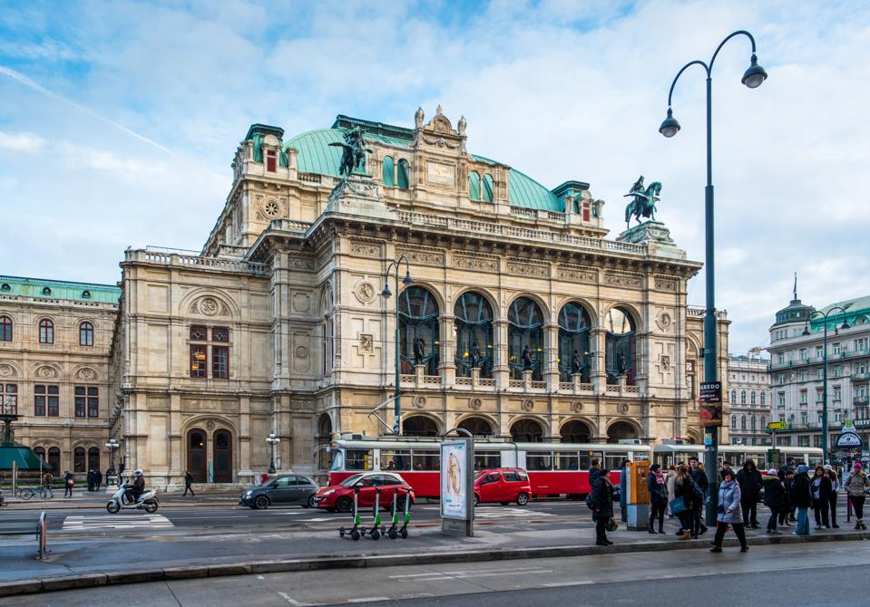 Trams pass the State Opera House on Ringstrasse, Vienna, Austria