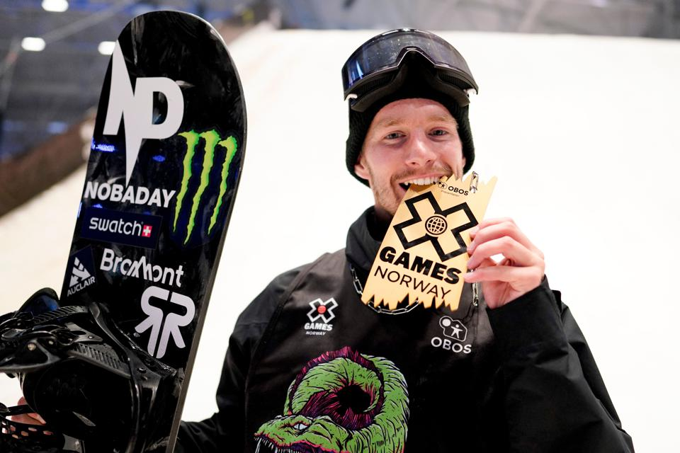 Max Parrot poses after winning the 2019 X-Games Big Air snowboard competition.