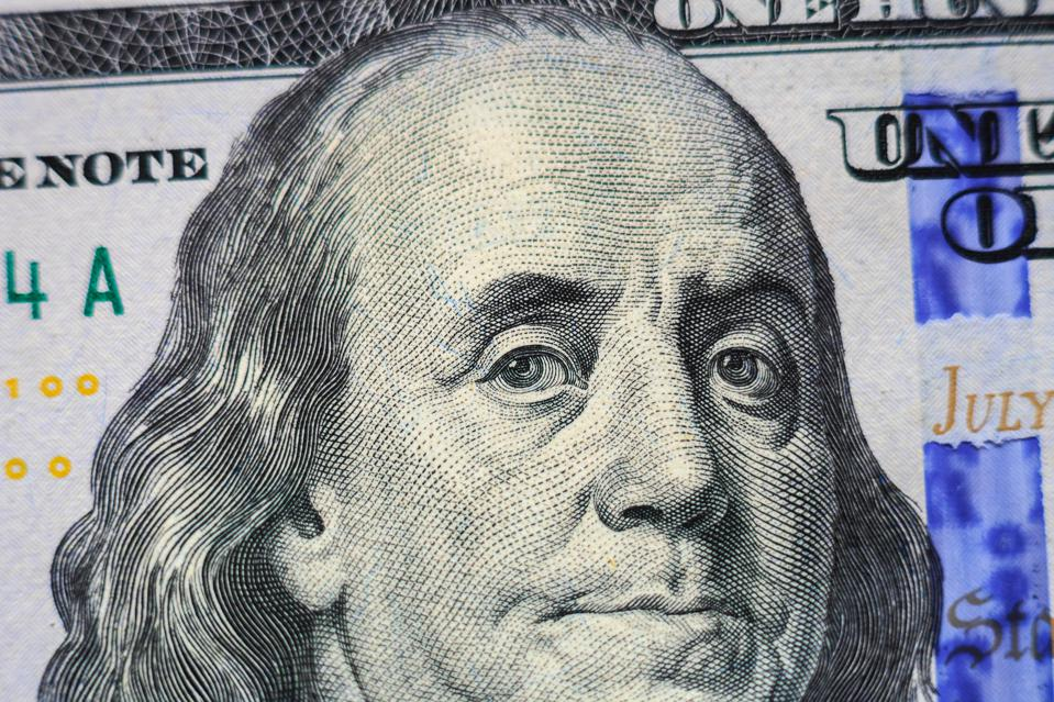Benjamin Franklin portrait on 100 dollar banknote closeup
