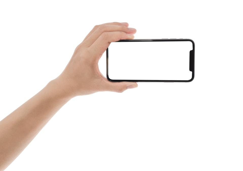 close up hand hold phone isolated on white, mock-up smartphone.