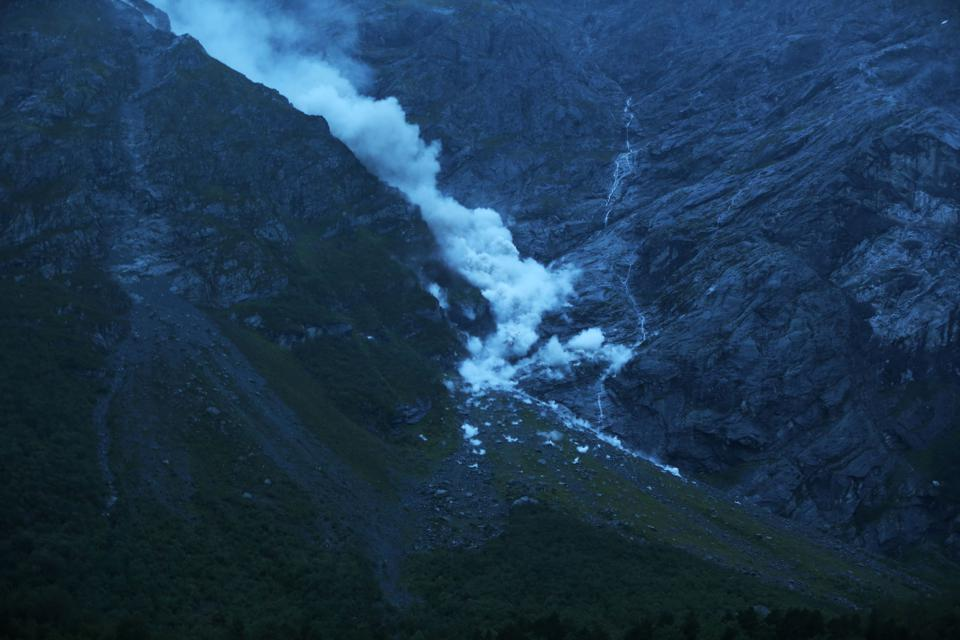 Smoke billows as parts of the unstable mountain Veslemannen in Norway collapsed on September 5, 2019.