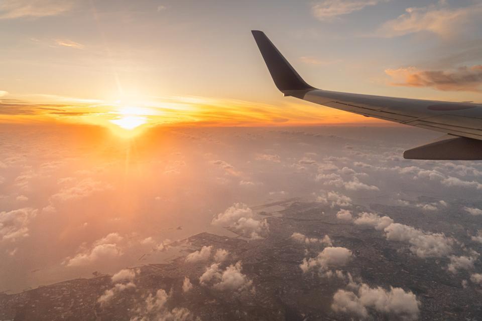 Wing and sunset over Okinawa Island