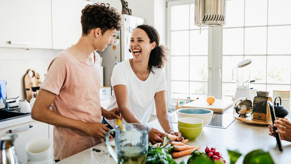 Single Mom Laughing While Preparing Lunch With Son