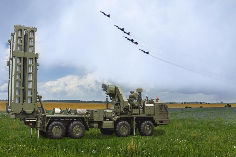 The S-300 missile system against the background of Russian military aircraft