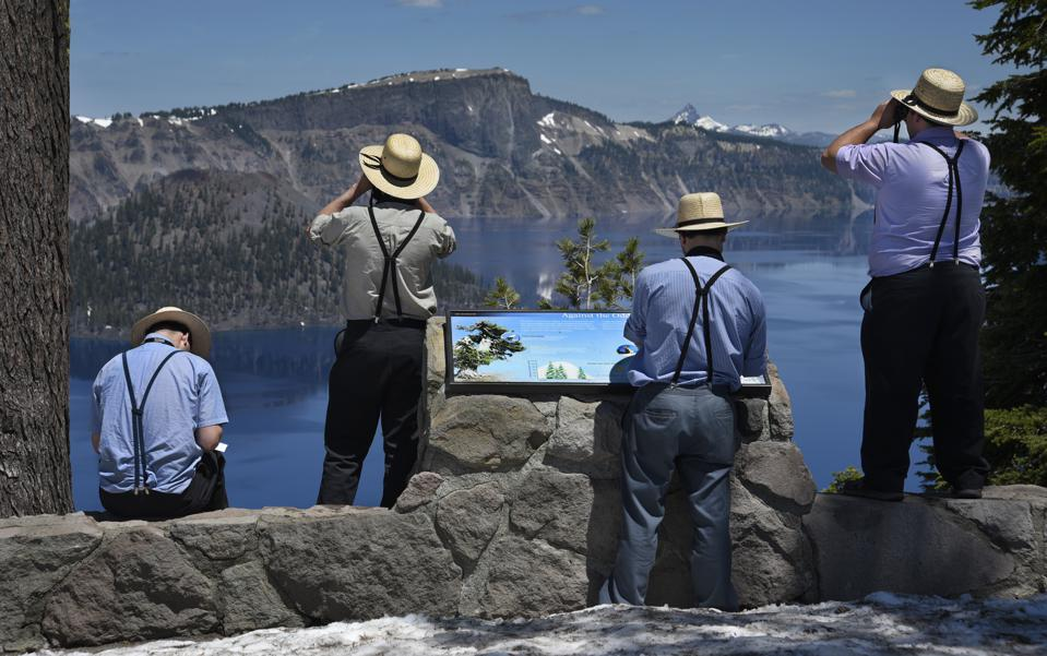Amish men visit Crater Lake National Park in Oregon, USA
