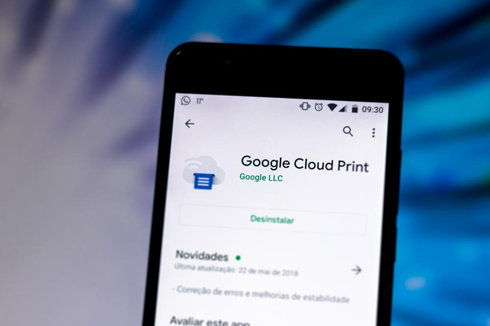 In this photo illustration the Google Cloud Print logo is...