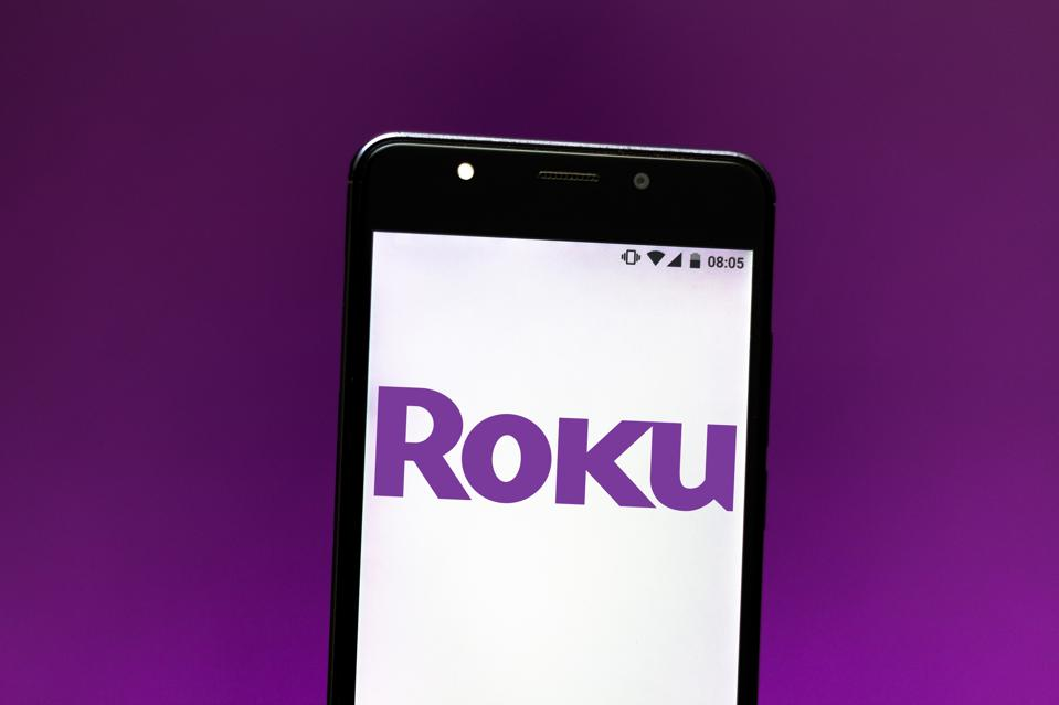In this photo illustration the Roku Streaming Player logo is...