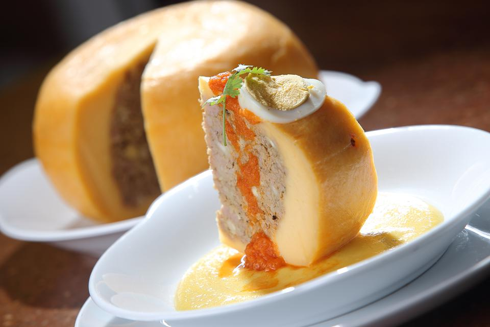 Edam cheese stuffed with beef stew with tomato sauce and hard-boiled egg.