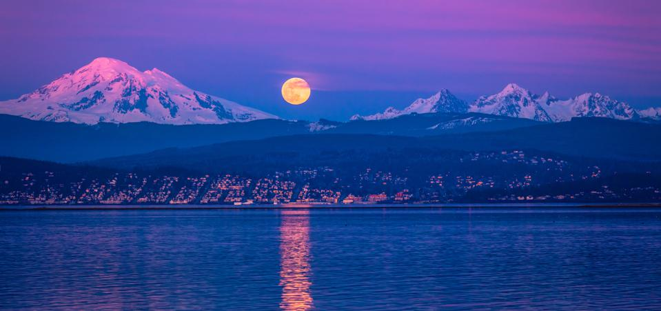 A supermoon rises over Mt Baker.