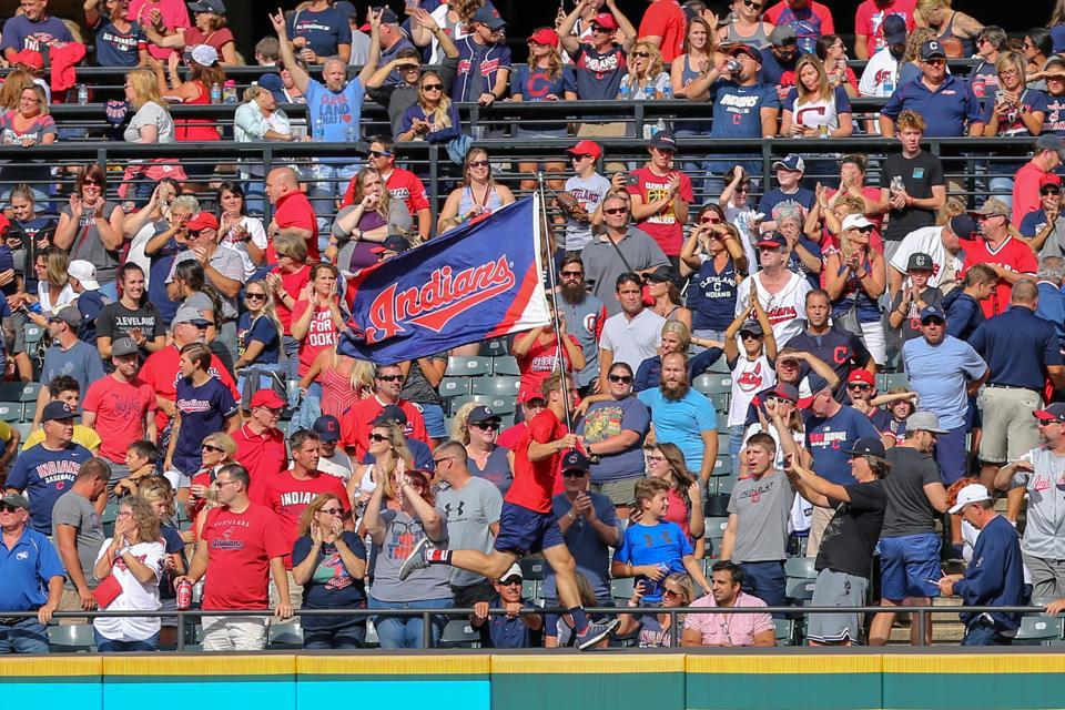 Cleveland Indians fans celebrate.