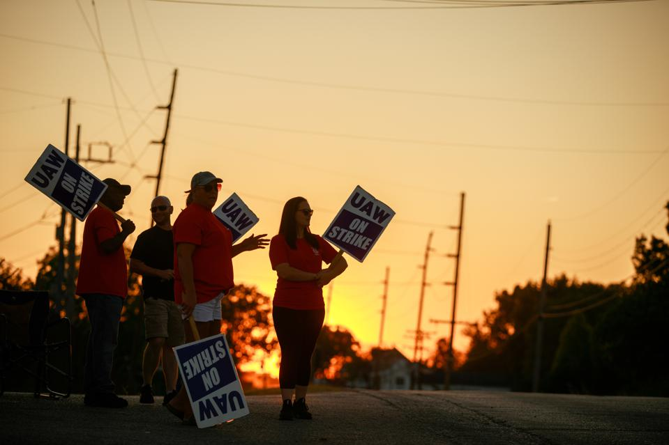 Workers from United Auto Workers Local 440 picket outside...