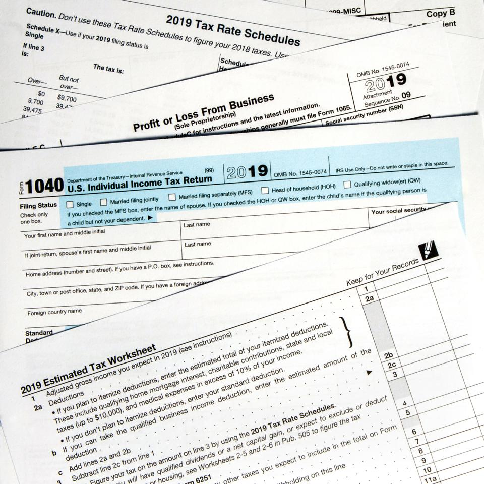 2019 IRS tax forms lay on a desktop.