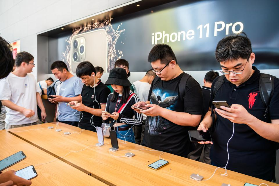 Customers look at the Apple's new iPhone 11 series.