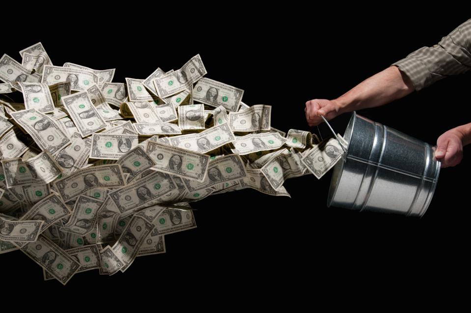 Throwing a bucket of money