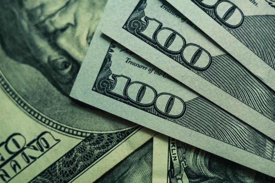Close up Beautiful Dollars Background. American, US Dollars Cash Money. One Hundred Dollar Banknotes. Macro view.