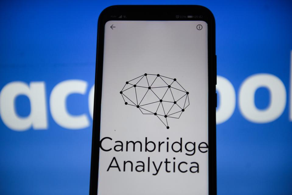 In this photo illustration a Cambridge Analytica logo seen...