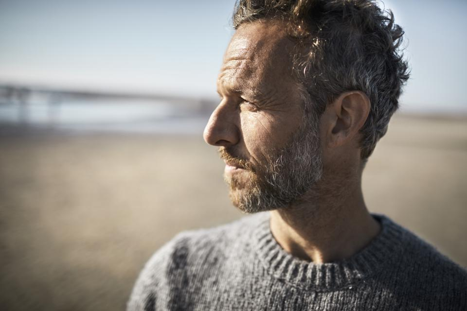 Portrait of pensive mature man on the beach