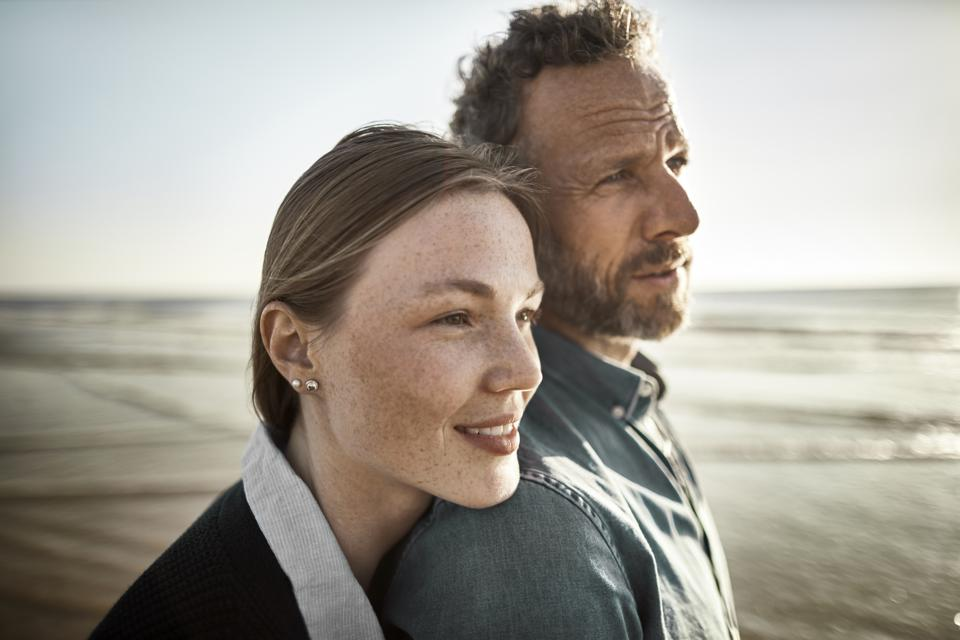 Portrait of man and young woman by the sea