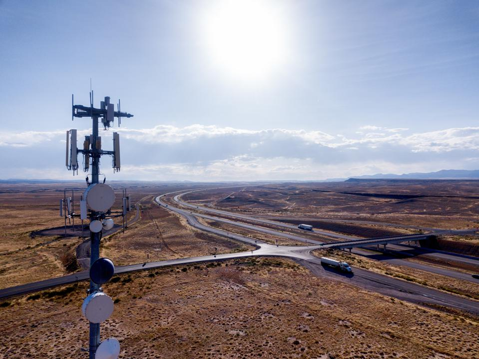 Cellular Repeater Tower in a Desert, Aerial shot in the summer