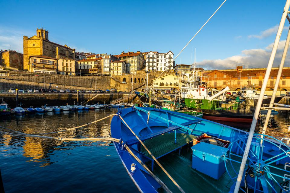 Colorful fishing boats moored at Getaria port, Basque Country, Spain