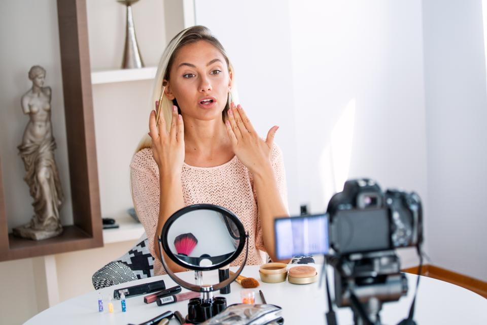 Professional beauty vlogger sharing cosmetic makeup tutorial on social media