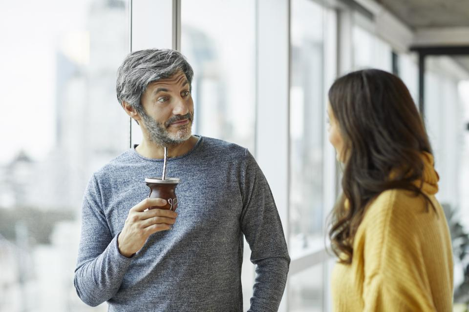 Surprised businessman discussing with colleague