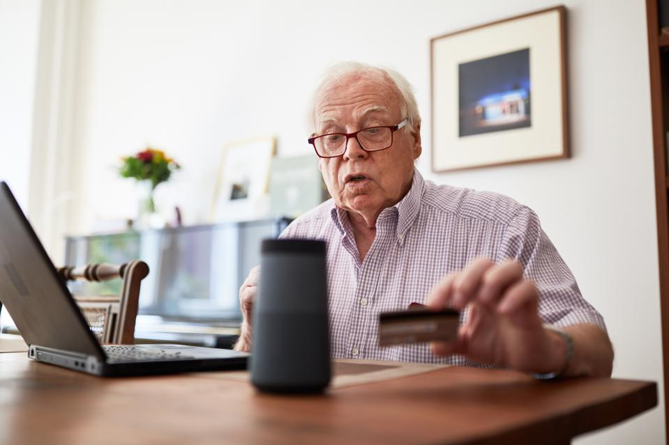 Elderly man doing online purchase at home