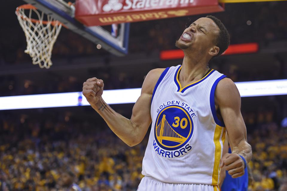 Golden State Warriors' Stephen Curry (30) reacts after making a layup against the Oklahoma City Thunder in the second quarter of Game 5 of the NBA Western Conference finals at Oracle Arena in Oakland, Calif., on Thursday, May 26, 2016. (Jose Carlos Fajard
