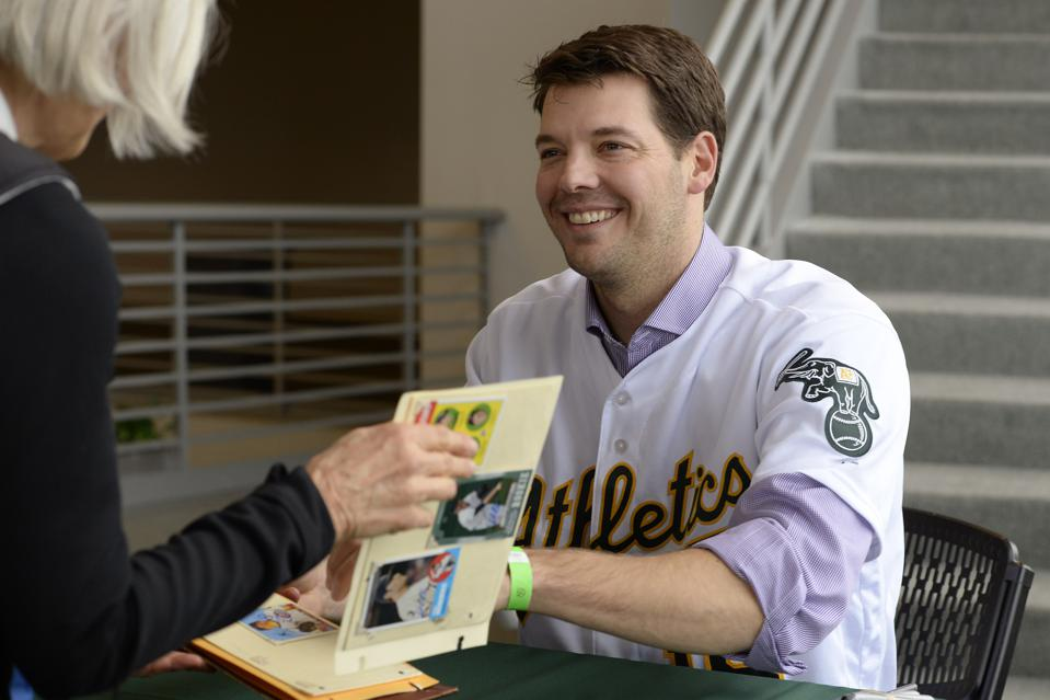 Oakland Athletics pitcher Rich Hill (18) smiles after autographing a baseball card for Cheryl Nyquist, of Denair, during the Oakland Athletics Fanfest in Oakland, Calif., on Sunday, Jan. 24, 2016. (Jose Carlos Fajardo/Bay Area News Group)