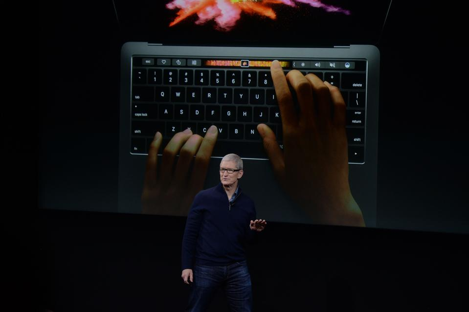 Apple CEO Tim Cook introduces the new MacBook Pro at a press event held at the company's headquarters in Cupertino, Calif., on Thursday, Oct. 27, 2016. (Dan Honda/Bay Area News Group)