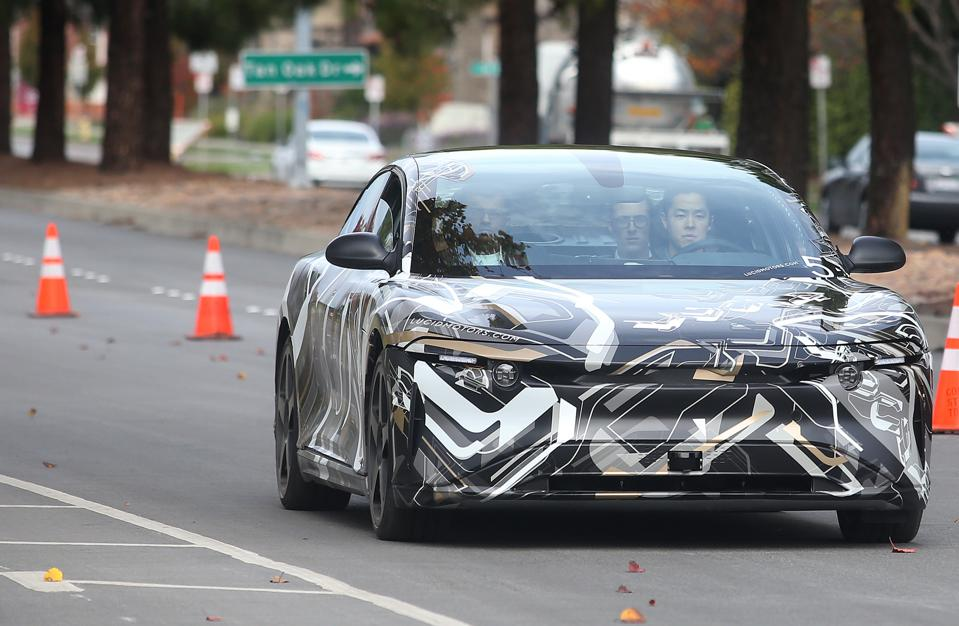 Guests take a test ride in the new ″air″ electric car by Lucid Motors Inc. on Wednesday, Dec. 14, 2016, in Fremont, Calif.   (Aric Crabb/Bay Area News Group)