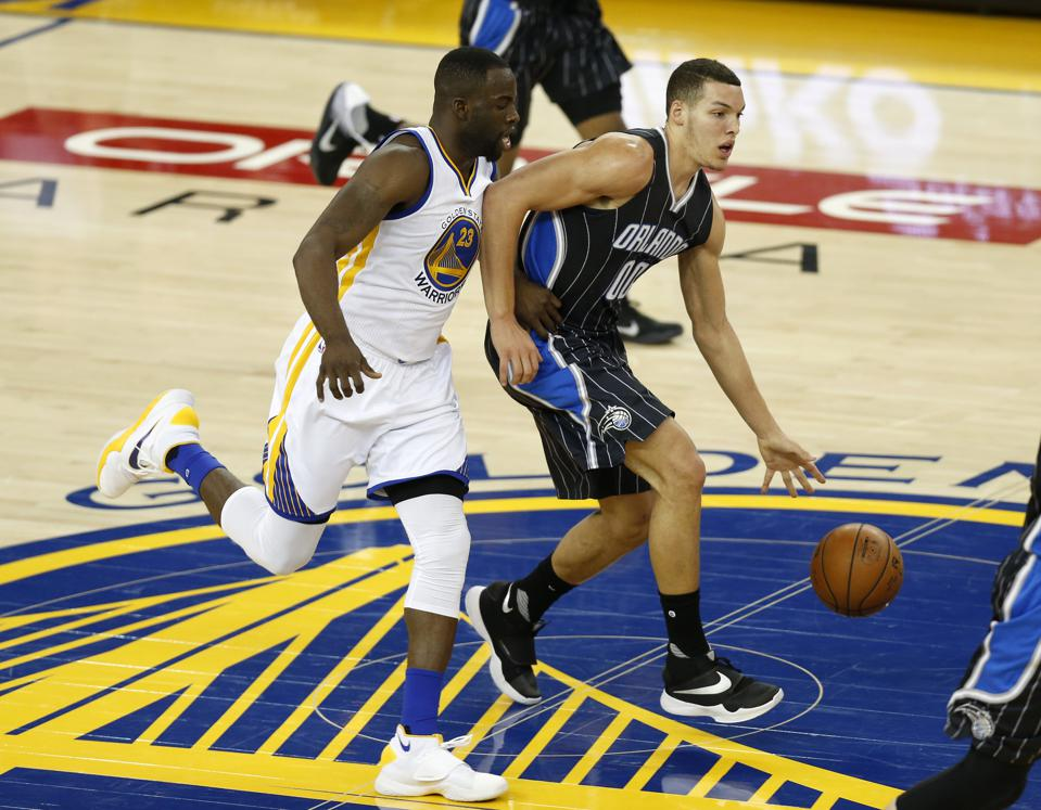 Orlando Magic's Aaron Gordon (00) dribbles against Golden State Warriors' Draymond Green (23) in the second quarter at Oracle Arena in Oakland, Calif., on Monday, March 7, 2016. (Nhat V. Meyer/Bay Area News Group)