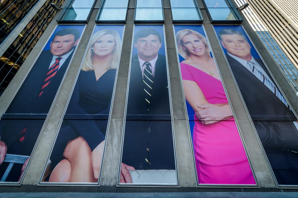 Giant portraits of the news achors at Fox News  hearquarters...