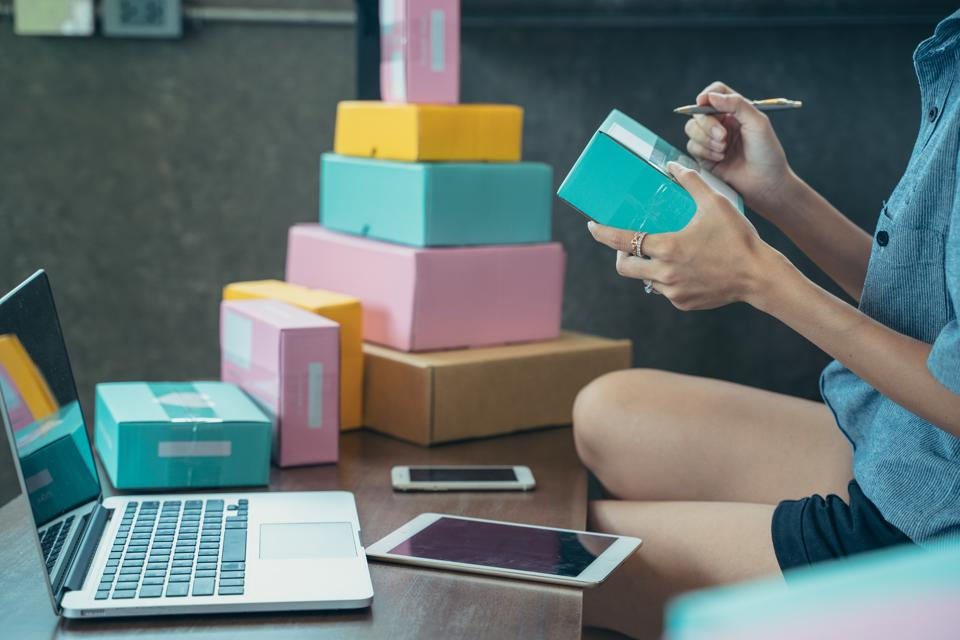 Asian teenager owner woman work at home for online shopping and sale