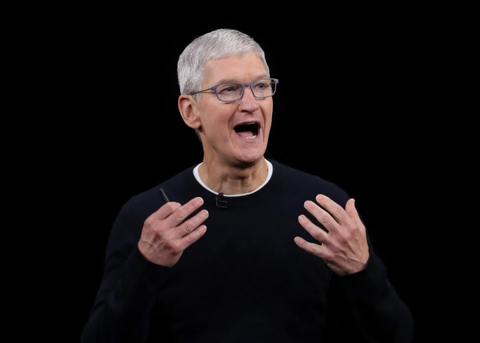 Tim Cook speaking in front of black background
