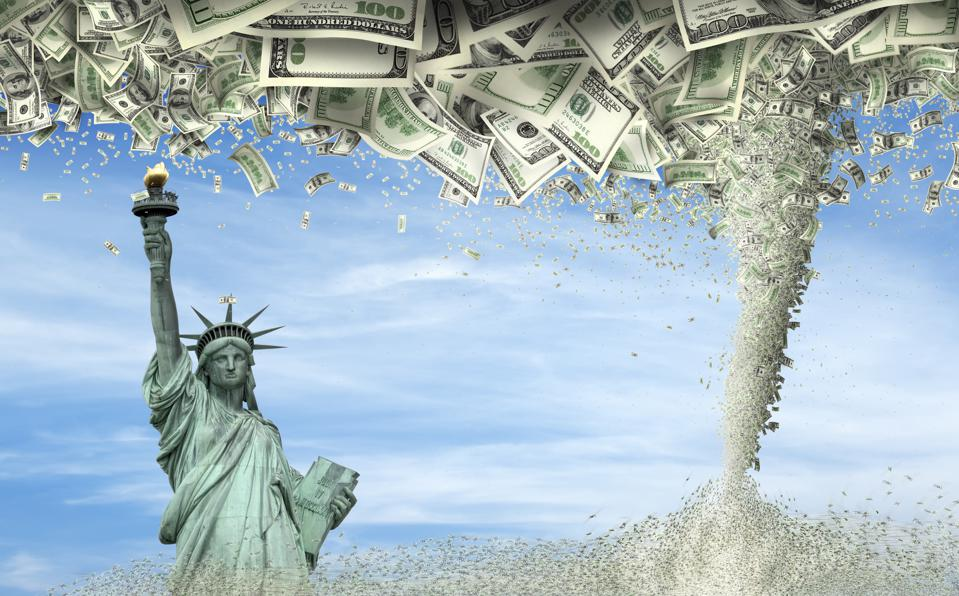 Conceptual image of statue of liberty under falling large group of money