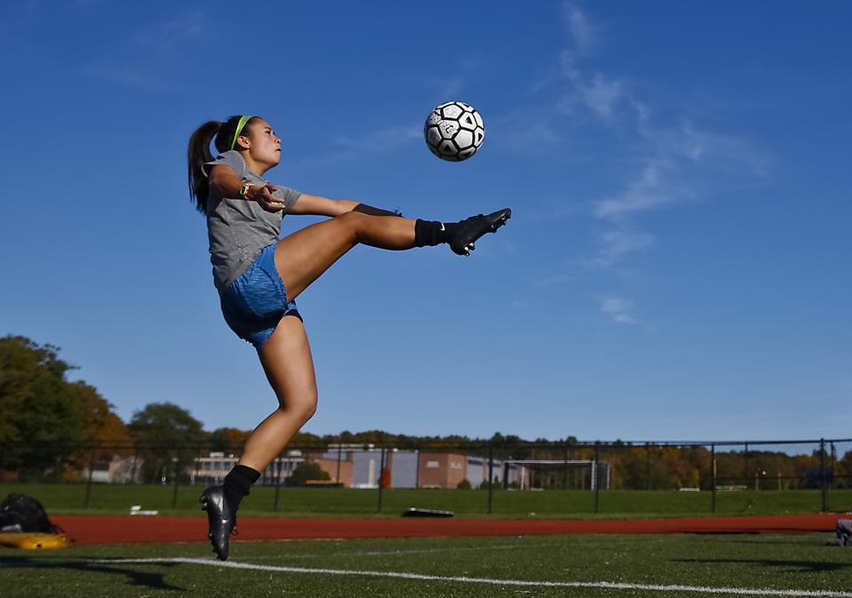 High school girls' soccer players experience almost as many concussions as male football players. (Photo by Matthew J. Lee)